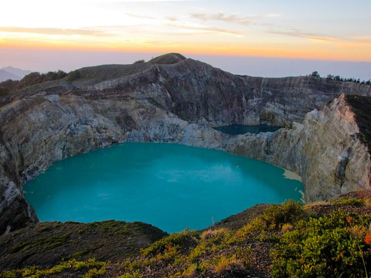 Kelimutu at sunrise over one of it's tri-coloured lakes