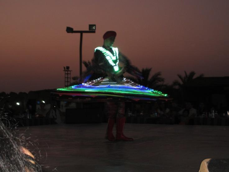 Brightly lit up Tanoura Dancer